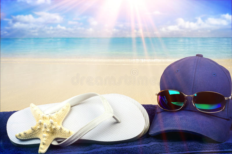 Beach scene with hat and flip flops stock image