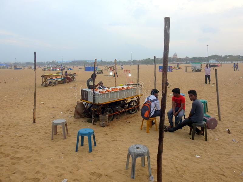 Beach scene Marina beach Chennai India. Selling mangoes.. Indiaselling stock photo