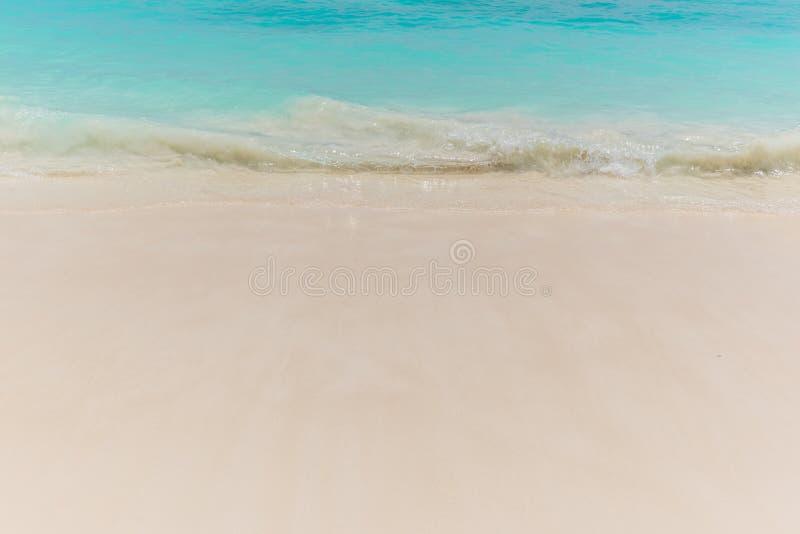 Beach scene showing sand. Soft Wave of blue ocean on sandy beach royalty free stock photo