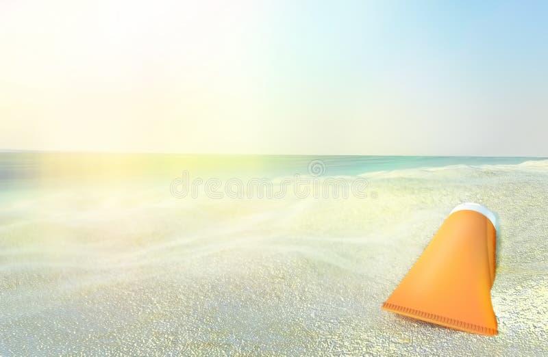 Beach scene with sunscreen against ocean background. stock photo