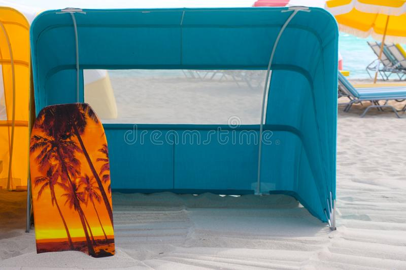 Beach scene with a beach tent in Miami beach royalty free stock photography