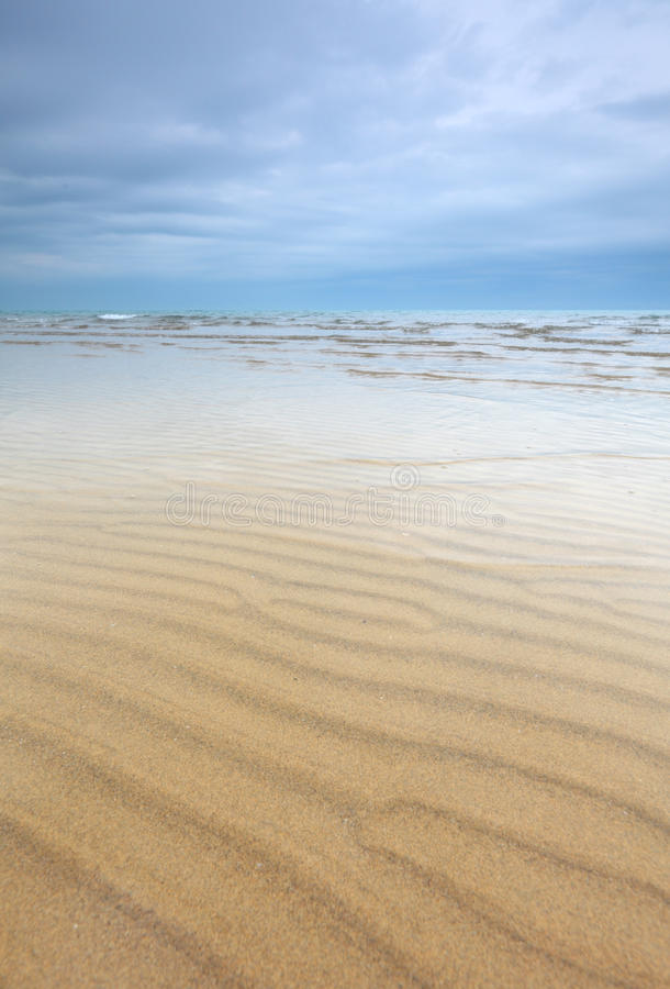 Free Beach Scene With Sand Ripples And Beautiful Sky Royalty Free Stock Photography - 18124237