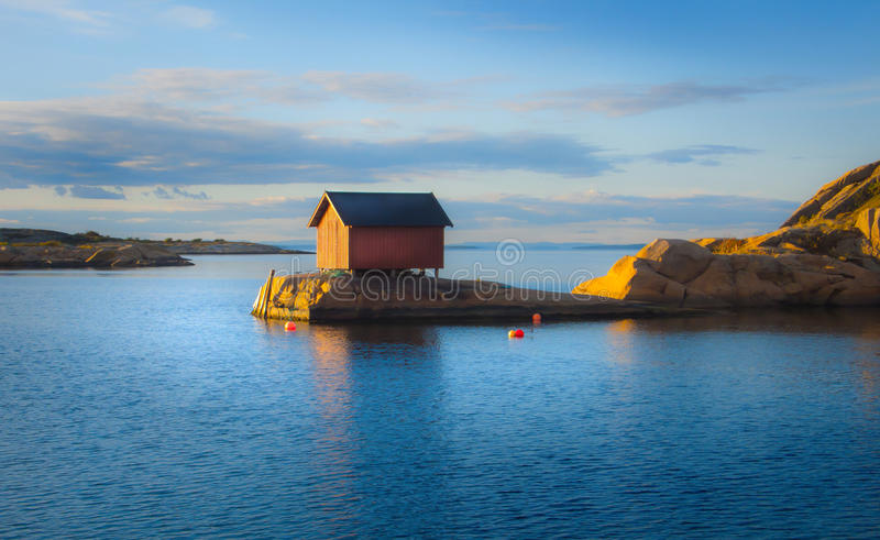 Beach scenery with fishing cottage. In Norway royalty free stock photo