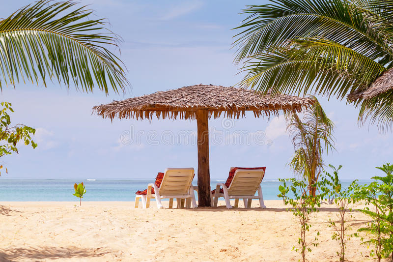 Download Beach Scenery With Parasol And Deck Chairs Stock Photo - Image: 29628944