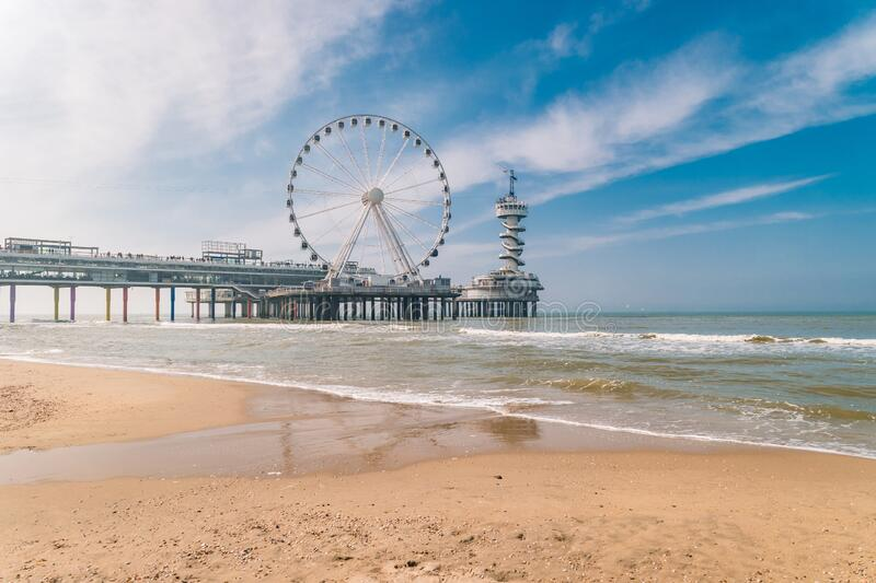 Beach of Schevening Netherlands during Spring, The Ferris Wheel The Pier at Scheveningen in Netherlands, Sunny spring. Day at the beach Holland stock photography