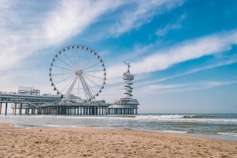 Beach of Schevening Netherlands during Spring, The Ferris Wheel The Pier at Scheveningen in Netherlands, Sunny spring. Day at the beach Holland stock photo