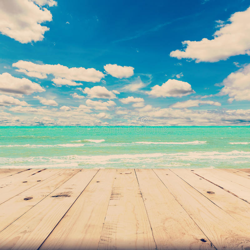 Beach sea and blue sky clouds with wood table stock images