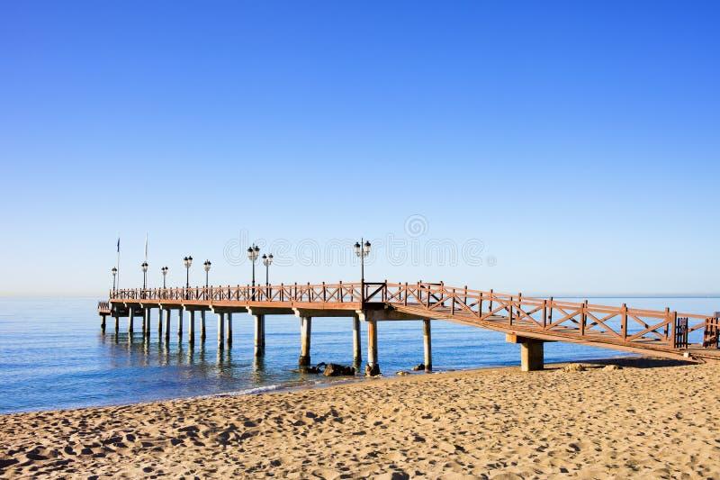 Beach Sea and Pier in Marbella stock photo