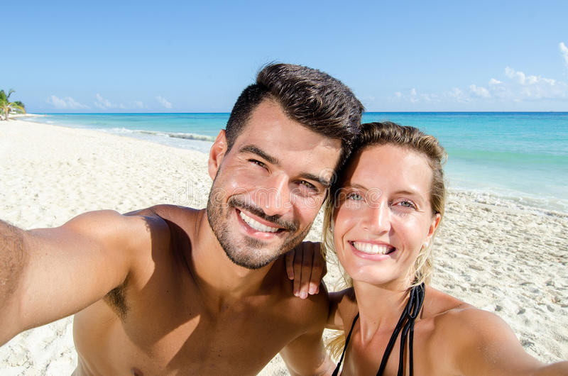 Beach. Selfie couple in love. Beach. Selfie young couple in love stock photo