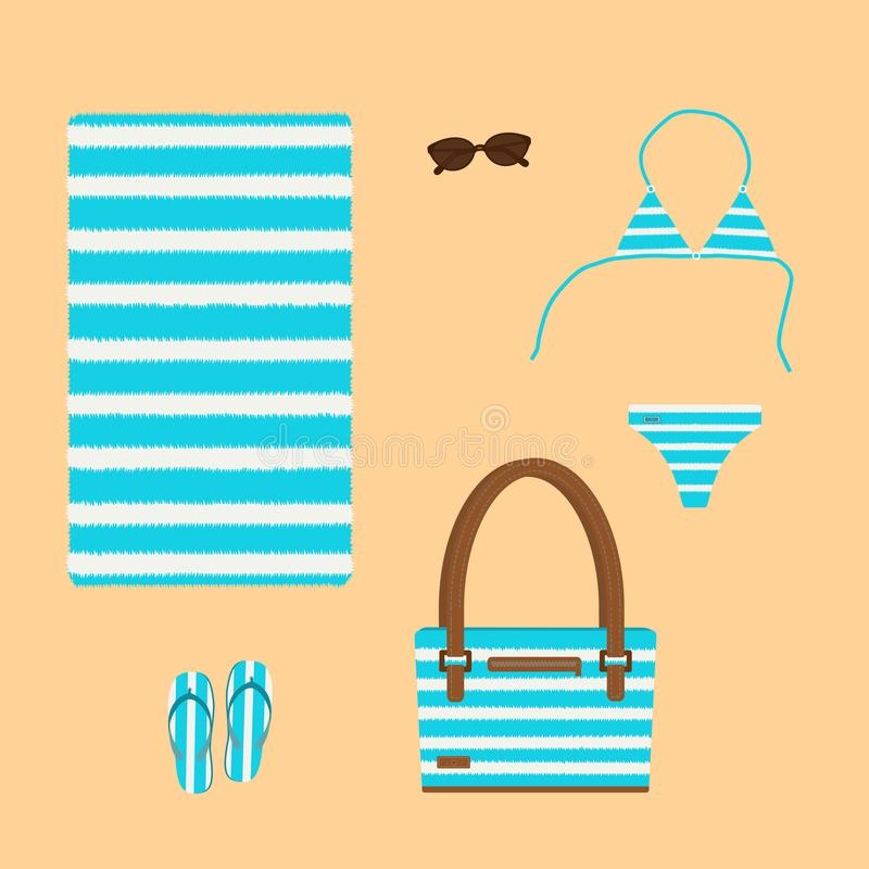 Beach set of bag, towel, bikini, glasses and slippers on sand background. royalty free stock photos