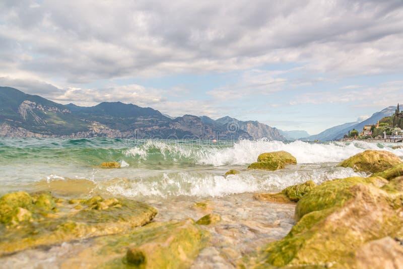 Beach shore on the lake Garda in Italy stock photos