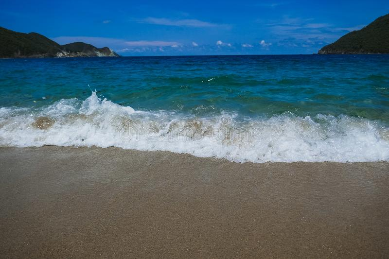 Beach Shore Water Coming in Sand Ocean Landscape Sunny Daytime Vacation Warm Tropical Weather Environment stock image