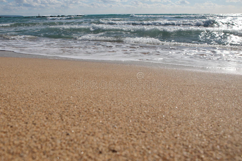 Beach shoreline. Mediterranean beach of El Arenal , sand and shore on a sunny day, in the Spanish balearic island of Mallorca royalty free stock photos