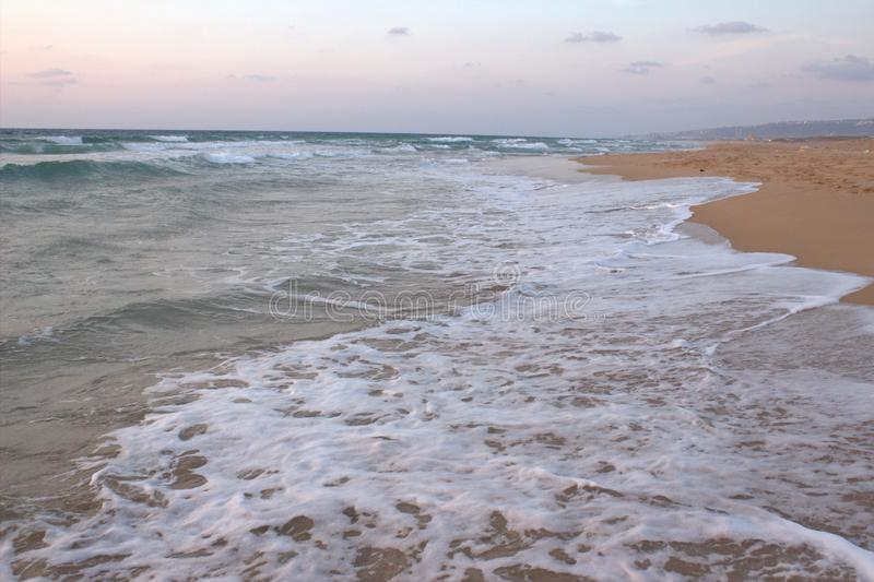 A beach short. Waves hits a beach short in atlit city royalty free stock image