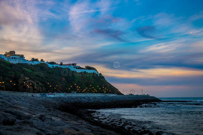 Beach side with beautiful and colorful sky. Tangier, Morocco stock photography