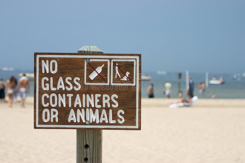 Beach Sign. A beach sign prohibiting pets and glass containers royalty free stock photography