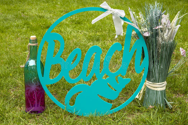 Beach. A beach sign with a wine bottle and centerpiece royalty free stock images