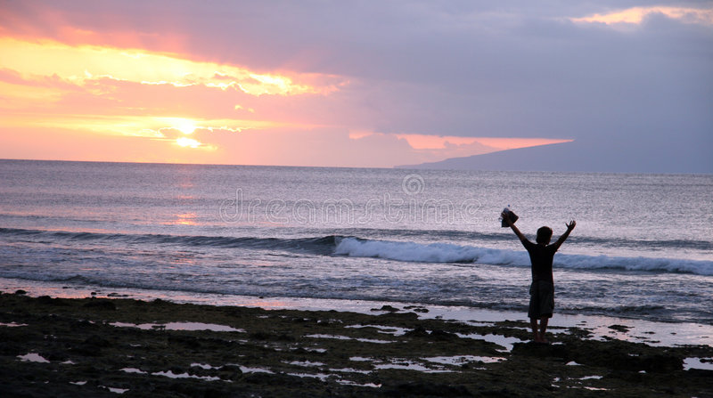 Beach silhouette. Man silhouette at the beach. Sunset royalty free stock image