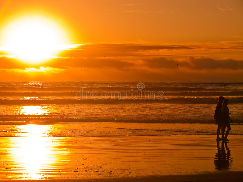 Download Beach Silhouettes At Sunset 4 Stock Image - Image: 7516159