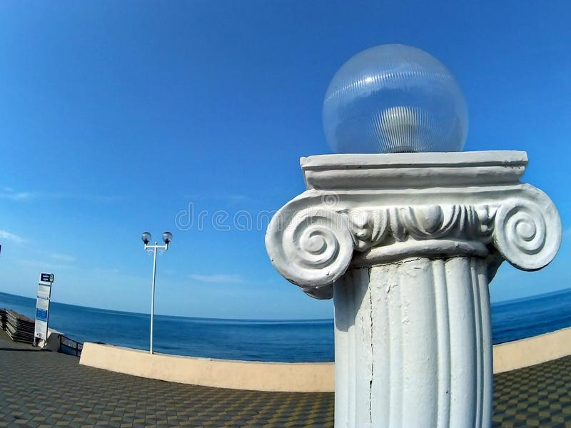 Beach sketches in the city of Sochi, the Black Sea. Quay. Coast. Balusters. Fence. Sea space. Lantern, old post. stock photography
