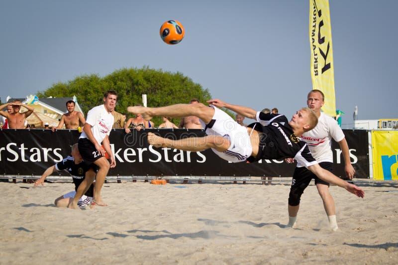 Beach soccer bicycle kick stock photo