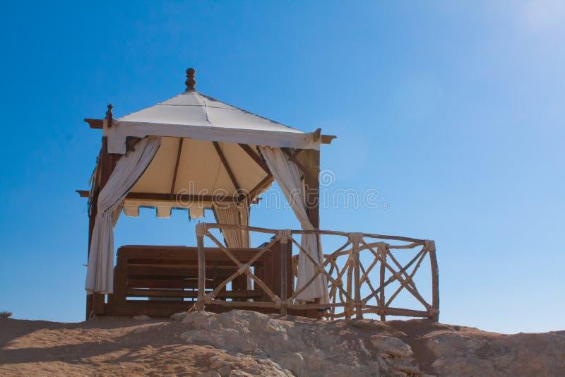Beach SPA. Beach massage gazebo on blue skies under sun royalty free stock images