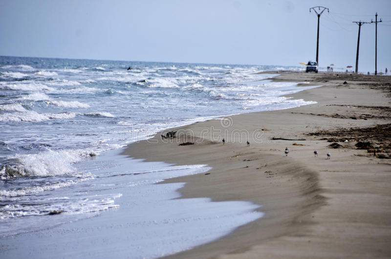 Beach. Of the Spanish coast of dark sand and soft surge and agreeable and sunny climate stock photo