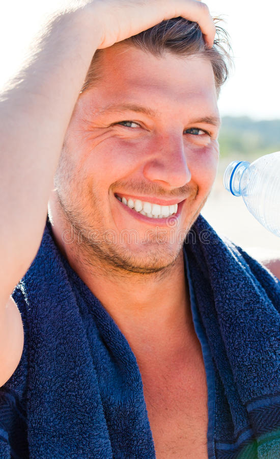 Beach sport towel man stock photography