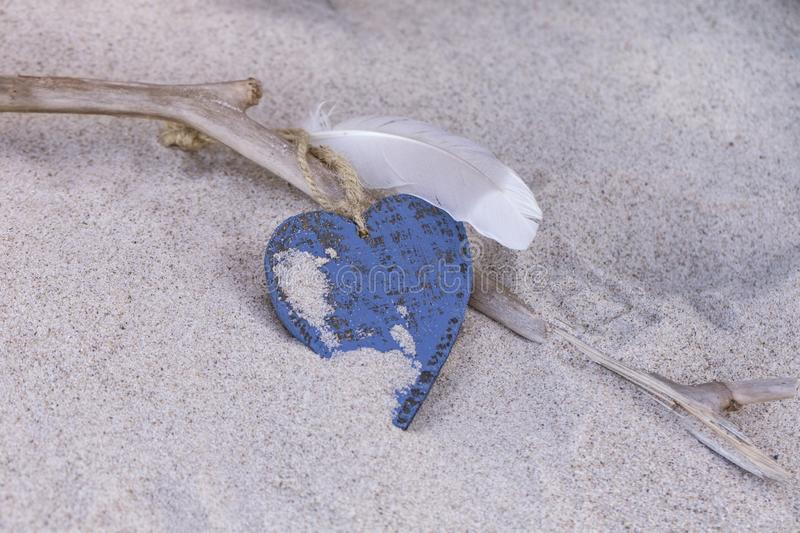 Beach Still Life With Blue Heart And Feather stock photos