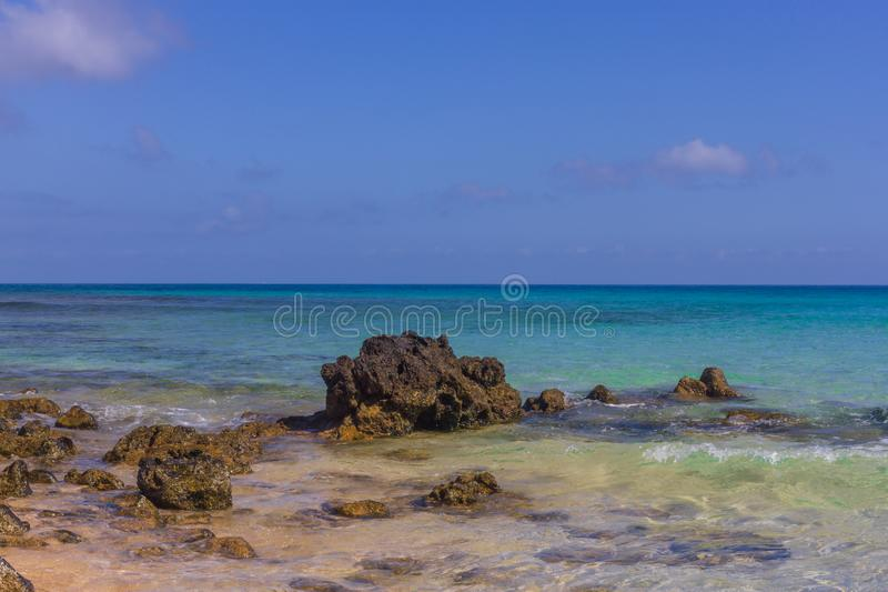 Beach stone . Horizon. Emerald water. Beach stone. Atlantic ocean. Lava calderas Coastal line stock photography