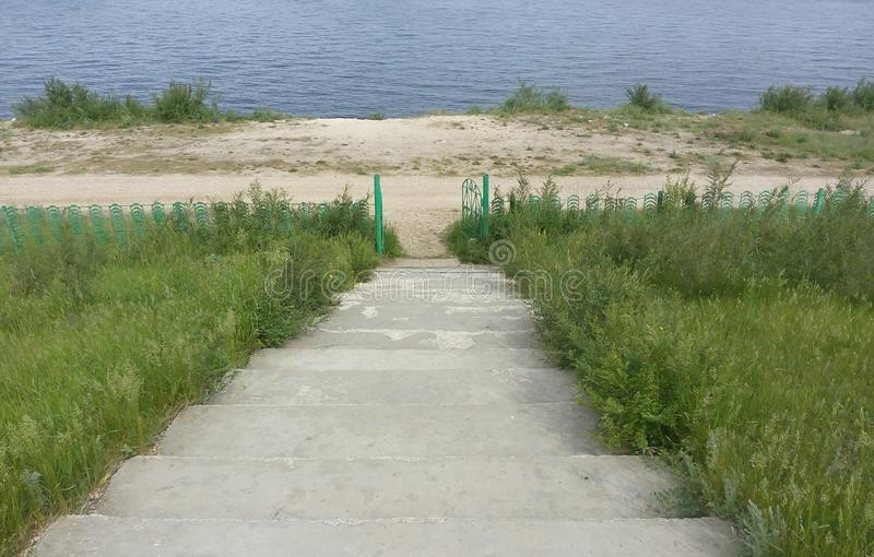 Beach, stone, stairs, background, steps, leading, water, beautiful, nature, blue, concrete, nowhere, lake, landscape, grass, recre royalty free stock photos