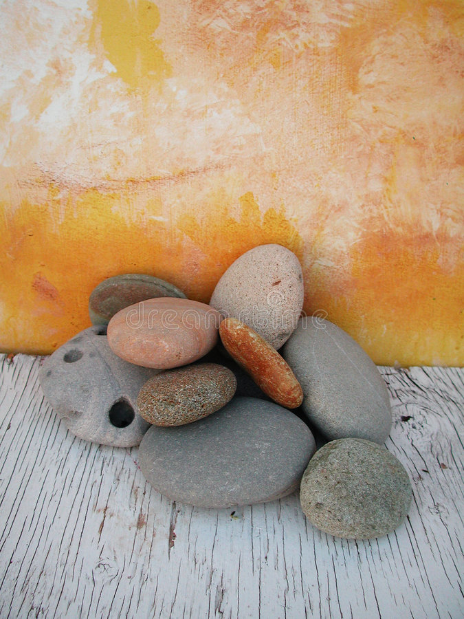 Beach Stones Natural Light Studio 1. Beach stones background created in a natural light studio with hand painted backgrounds royalty free stock image