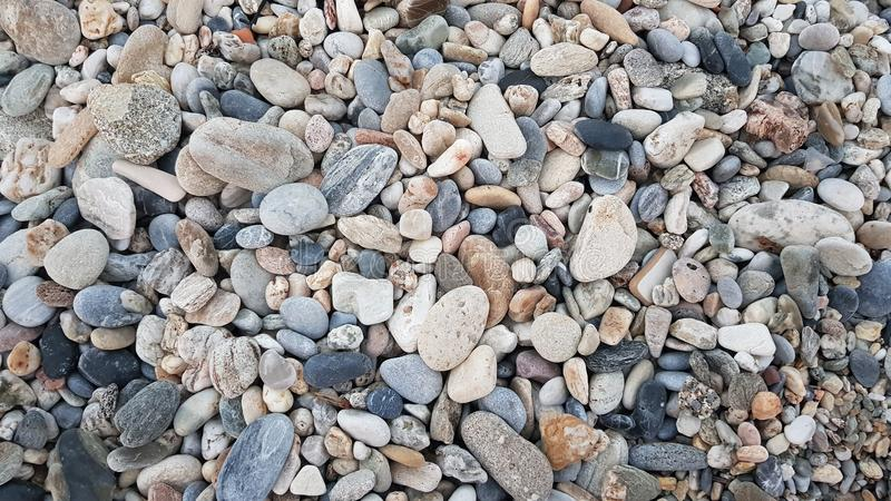 Beach stones for wallpaper. Big and small beach stones full screen. Good for wallpaper royalty free stock photography