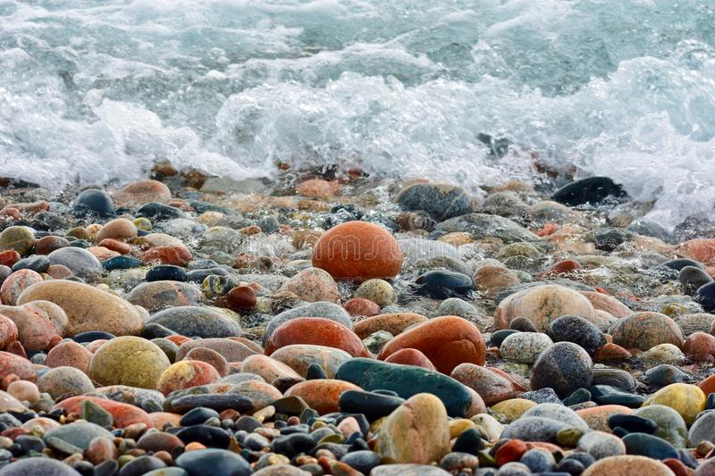 Beach Stones & Waves, Lake Superior, Ontario. Agate beach cobble stones create a colourful contrast to the cold waters of Lake Superior`s northern shore royalty free stock images