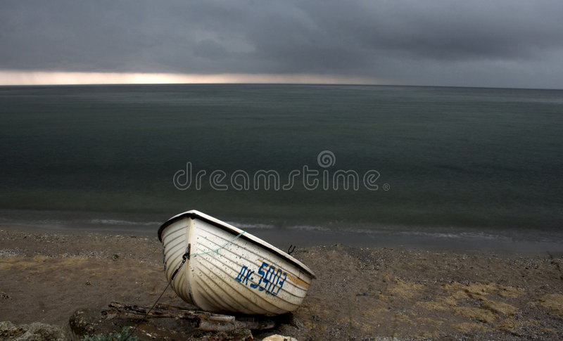 Beach in stormy weather royalty free stock photo