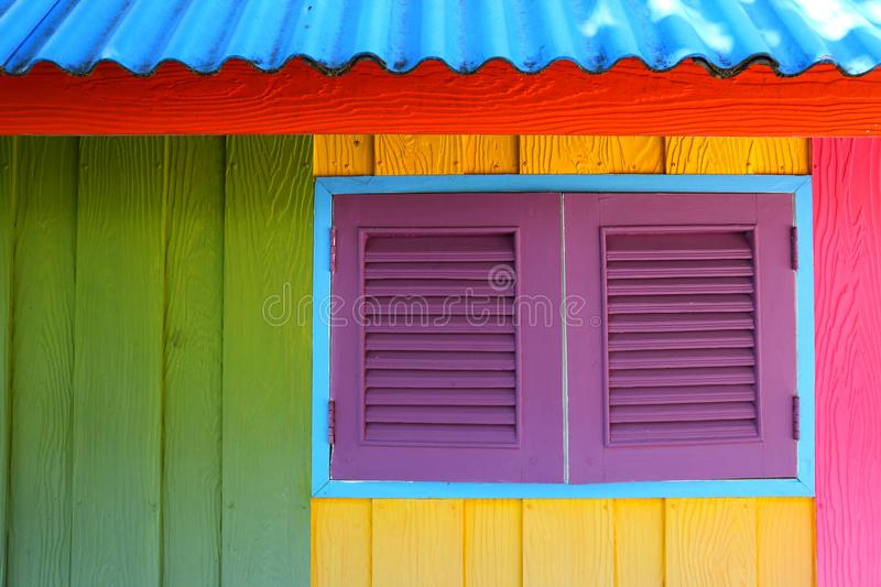 Beach style Caribbean house painted with primary colors in reggae decorative style royalty free stock photos