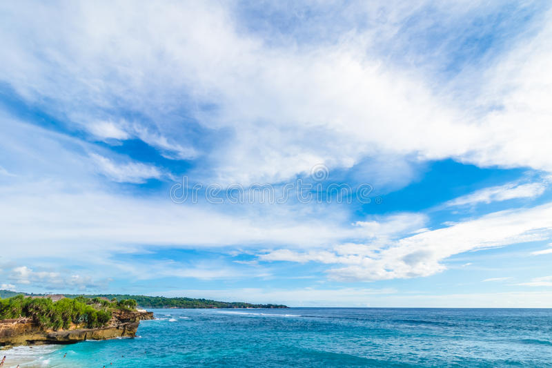 Beach summer with clouds, blue sky and palm tree. Beautiful tropical paradise for holiday and relax copy space stock photography
