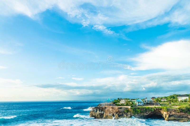 Beach summer with clouds, blue sky and palm tree. Beautiful tropical paradise for holiday and relax copy space stock photo