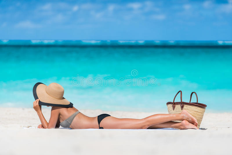 Beach summer vacation woman relaxing sunbathing royalty free stock photography