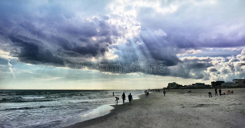 Beach Sunbeams. The sun bursting through the clouds, at Wrightsville Beach, NC royalty free stock images