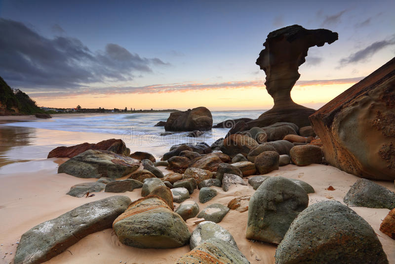 Beach Sunrise Noraville Central Coast NSW Australia. Beautiful natural sculptured rocks at Hargraves Beach Norabille NSW Australia royalty free stock photos