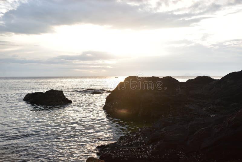Beach Sunrise and Rocks royalty free stock photo