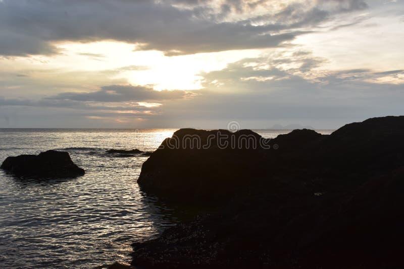 Beach Sunrise and Rocks royalty free stock image
