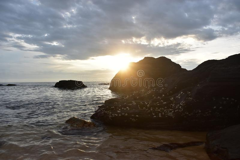 Beach Sunrise and Rocks royalty free stock images