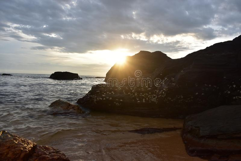 Beach Sunrise and Rocks stock photography