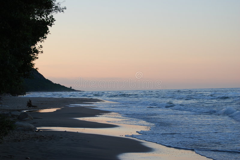 Beach in the sunset stock photography