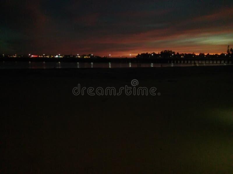 Beach sunset at boardwalk stock photos