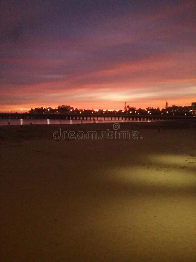 Beach sunset at boardwalk royalty free stock images