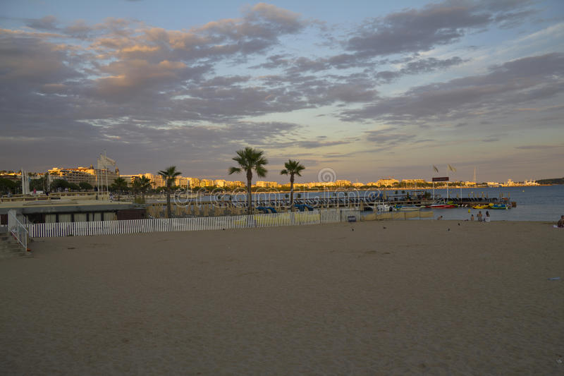The beach at sunset in Cannes, France. The beach at sunset in Cannes in France stock photography