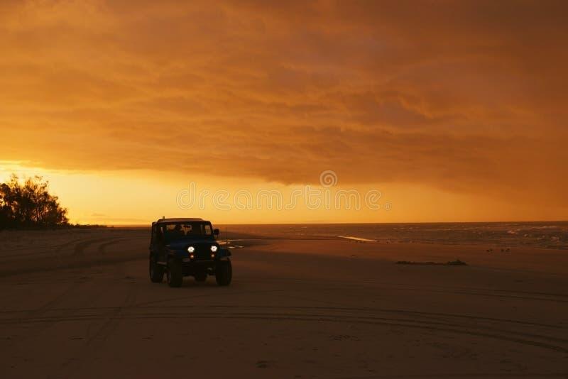 Beach sunset driving stock image